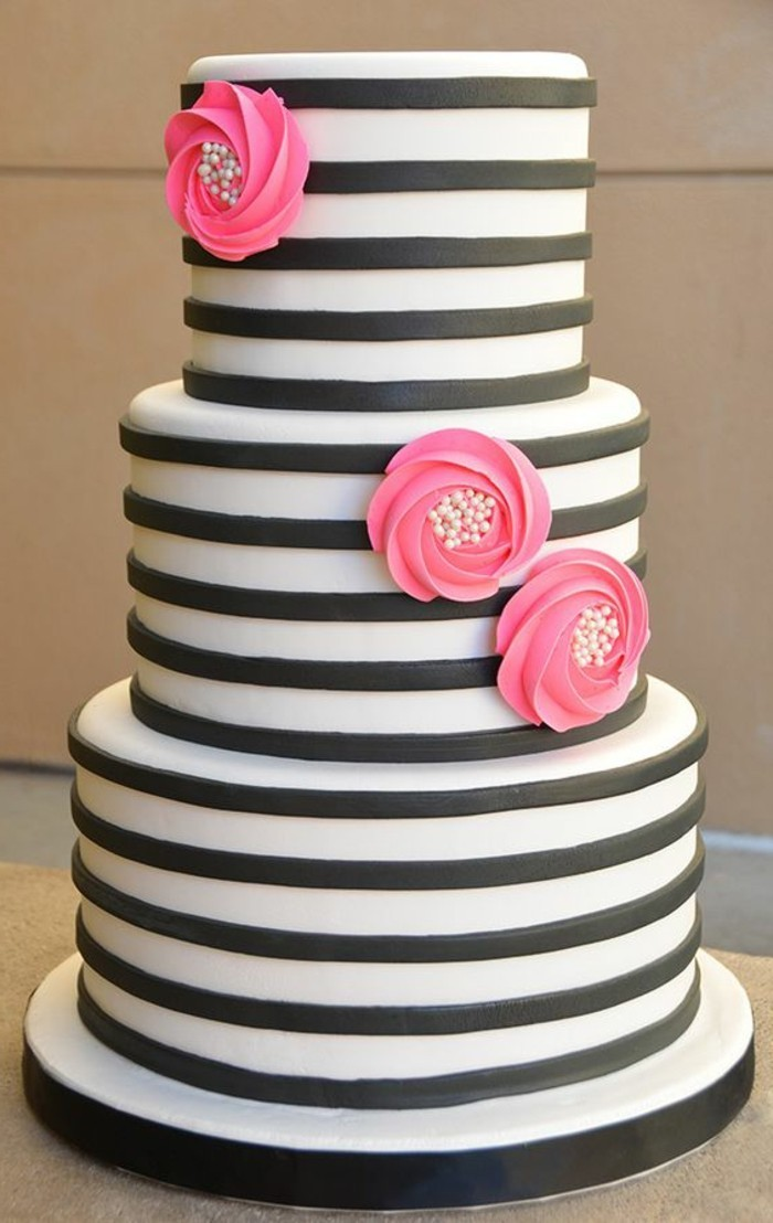 pies decorate wedding cake with white black stripes and flowers