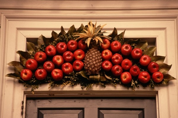 Rustic christmas decoration with apples for the front door