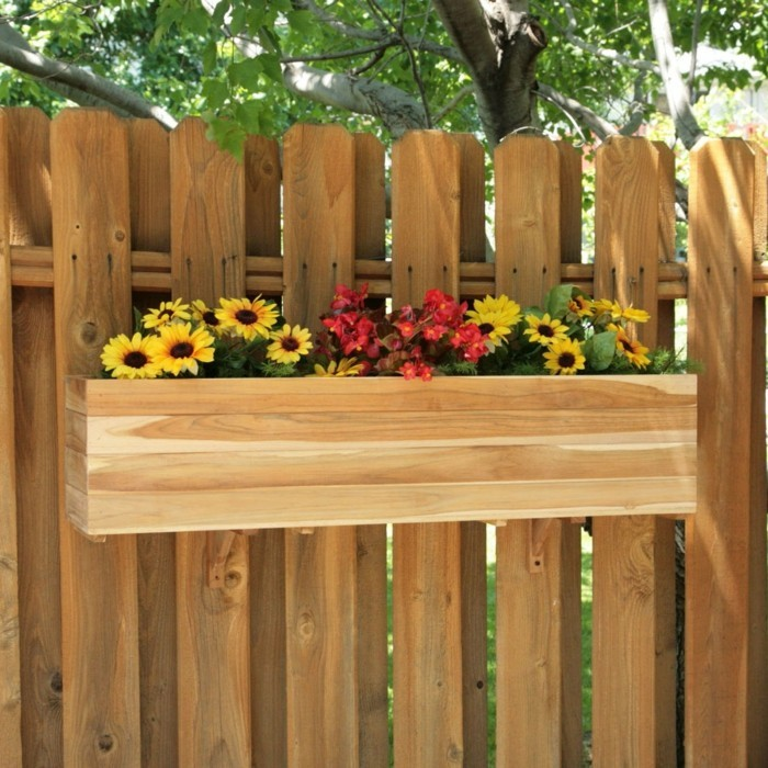 Decorating ideas Plant container hanging on the garden fence