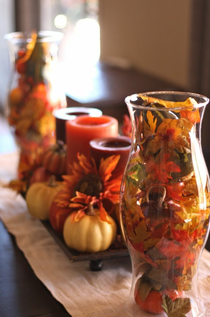 table decoration with autumn leaves and ornamental gourds