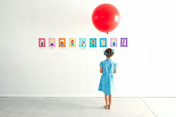 Decorating DIY decoration with children's drawings exhibiting walls