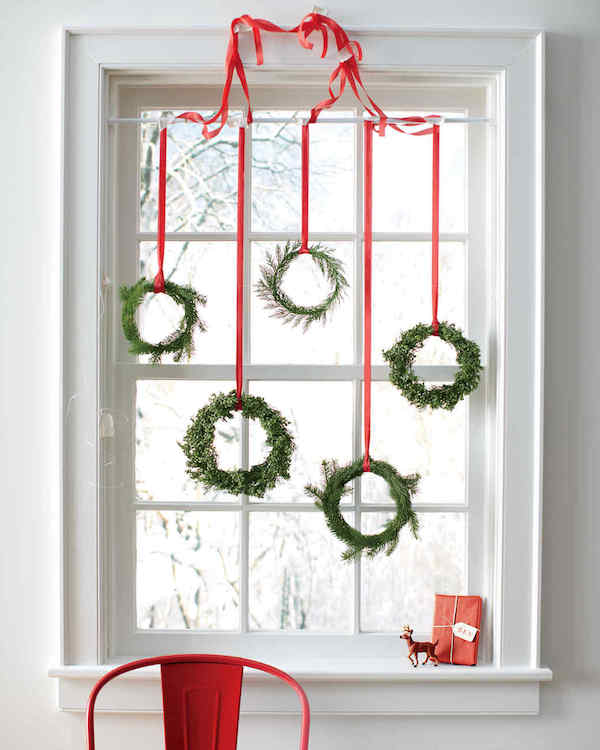 window decoration in advent red ribbons and green branches