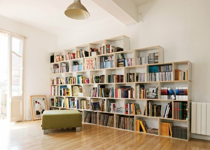 Flat decorate open bookshelves with many books