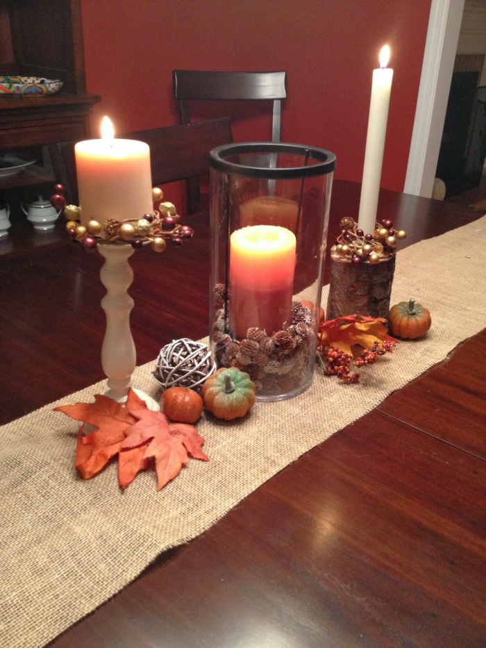 table decoration autumn candles and autumn leaves
