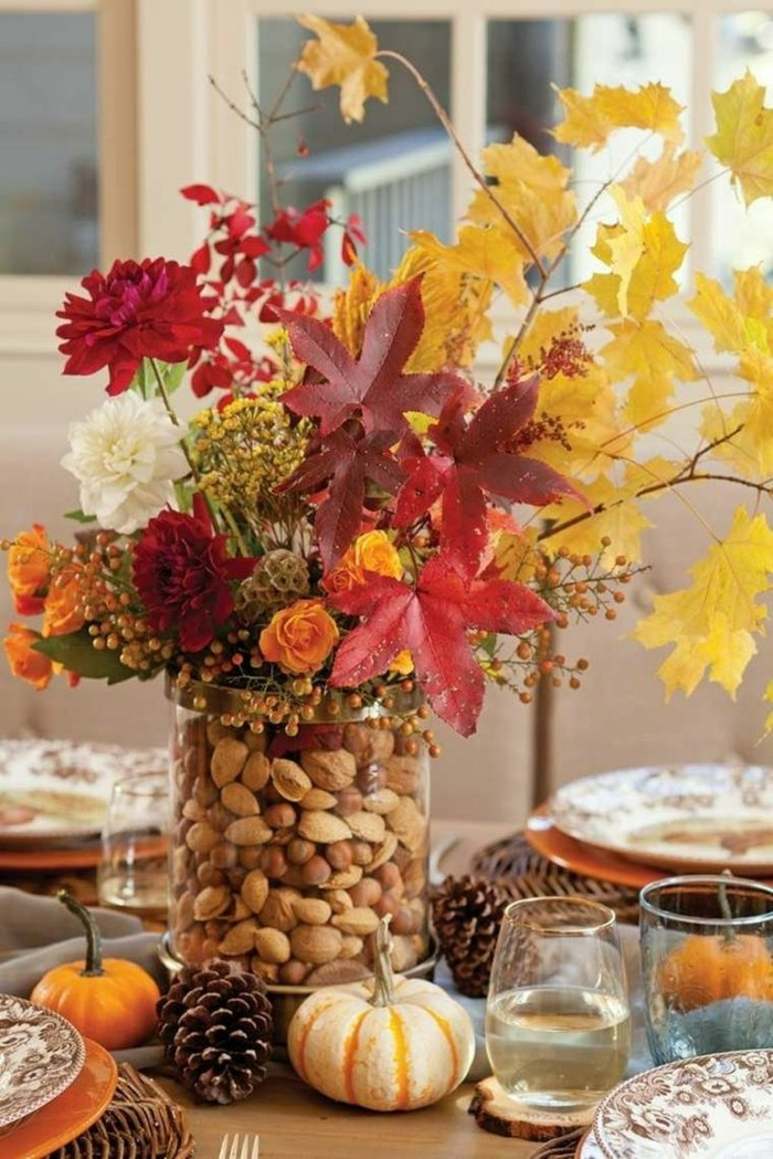 table decoration with pinecone leaves and flowers
