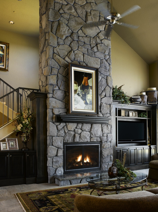 stone wall living room accent wall fireplace glass coffee table
