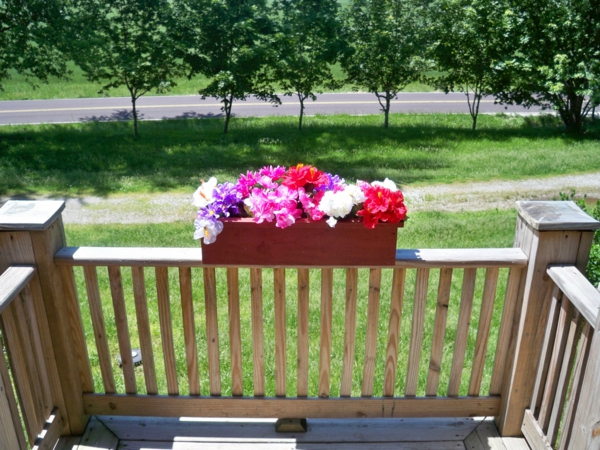 flowers balcony flower box brown design wooden railing