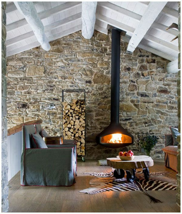 living room hanging fireplace fell carpet stone wall
