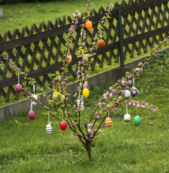 Easter decoration for outside Easter shrub with colorful eggs